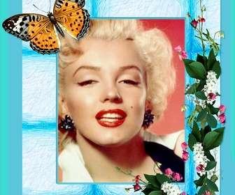 Inquadrare il foto con fiori e farfalle su sfondo blu.